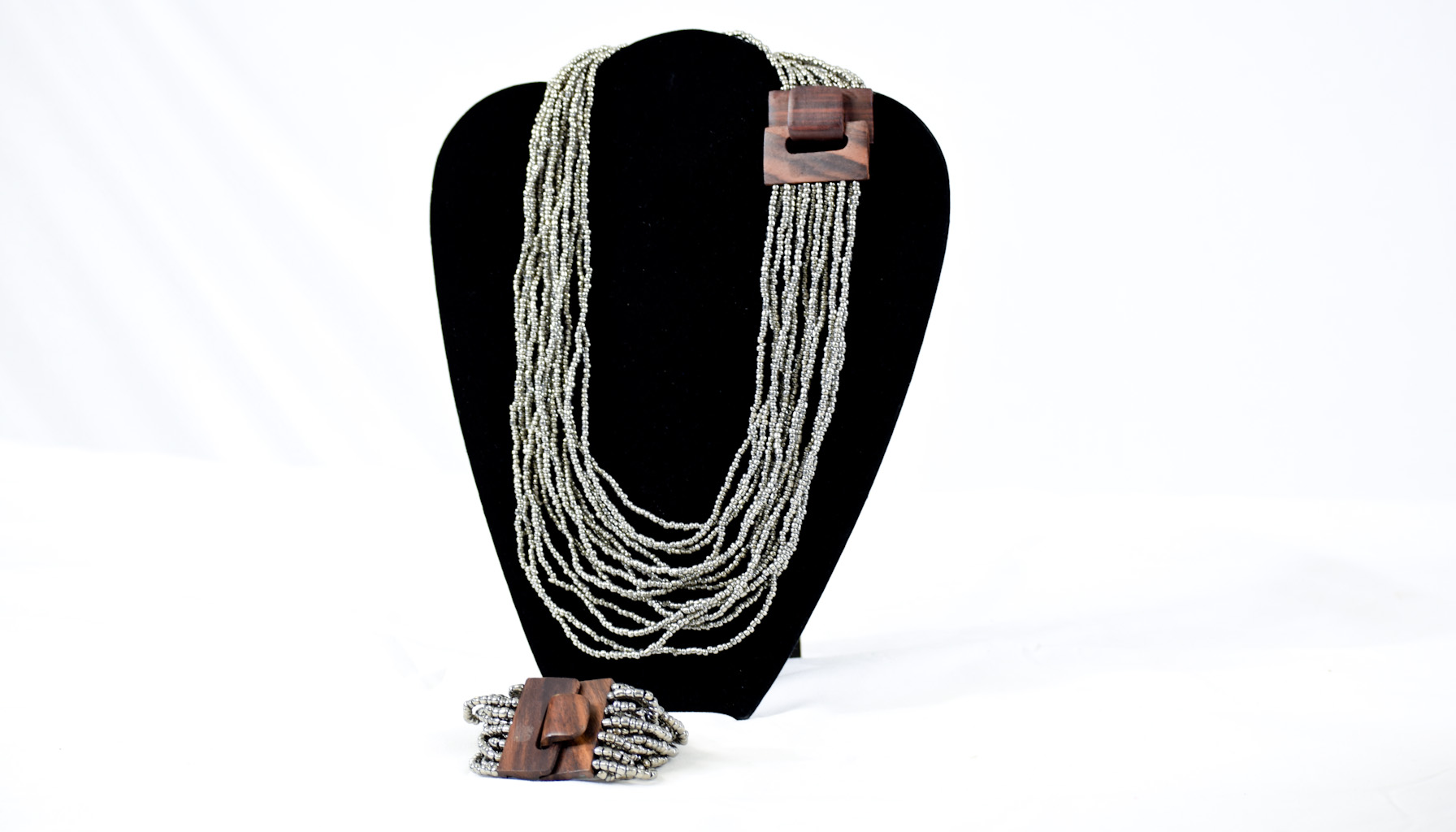 Multiple silver bead necklace & bracelet with wood clasp